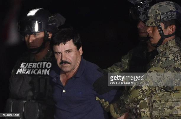 Drug kingpin Joaquin 'El Chapo' Guzman is escorted to a helicopter at Mexico City's airport on January 8 2016 following his recapture during an...
