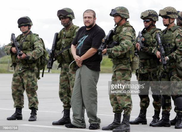Drug lord Diego Leon Montoya Sanchez aka Don Diego is escorted by Colombian soldiers in Bogota after being flown from where he was captured 10...