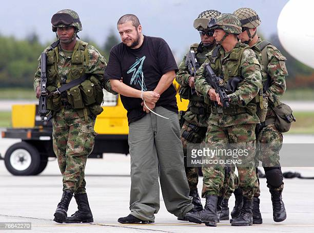 Drug lord Diego Leon Montoya Sanchez is escorted by Colombian soldiers in Bogota after being flown from where he was captured 10 September 2007...