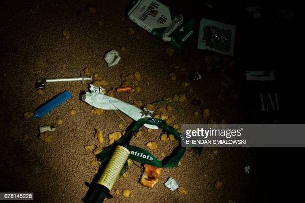 Drug paraphernalia and other garbage litter a vacant house on April 19 2017 in Huntington West Virginia Huntington the city in the northwest corner...
