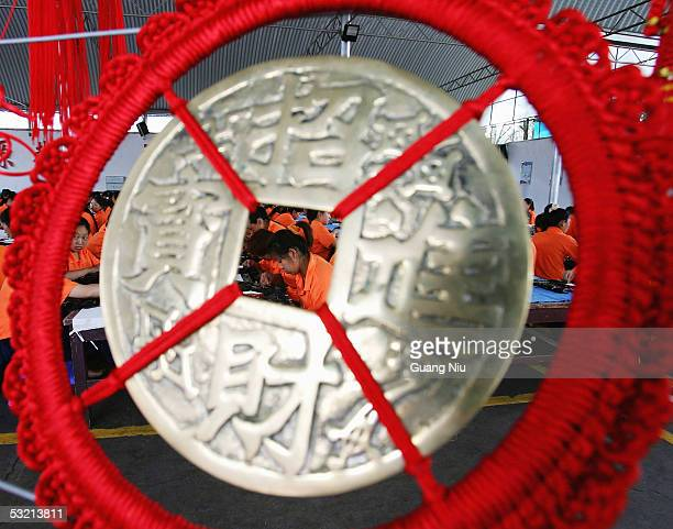 Drug rehab patients works behind their productions in a compound at the Kunming Municipal Compulsory Rehabilitation Center on July 8 2005 in Kunming...