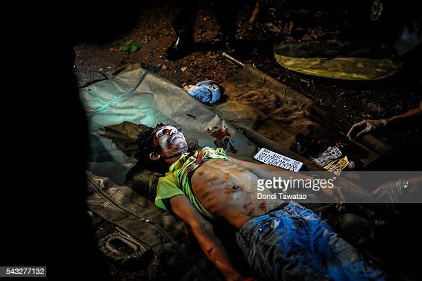 A drug suspect is killed in a shootout during a buy bust operation conducted by police on June 25 2016 in Manila Philippines The presidentelect of...
