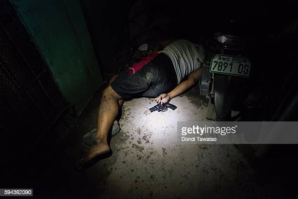 A drug suspect lies dead in a hallway during an alleged shootout with police on August 18 2016 in Manila Philippines The death toll from the...
