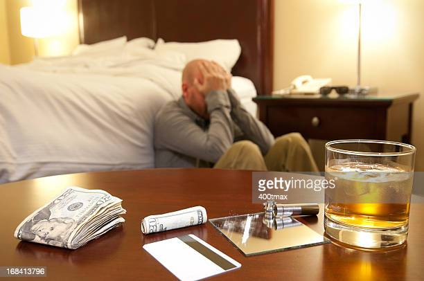 drug use and distraught man - hotel key stock photos and pictures