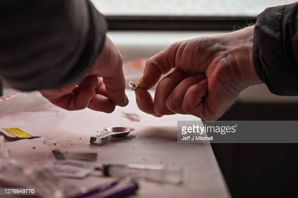 Drug user prepares heroin before injecting, inside of a Safe Consumption van set up by Peter Krykant on September 25, 2020 in Glasgow, Scotland....
