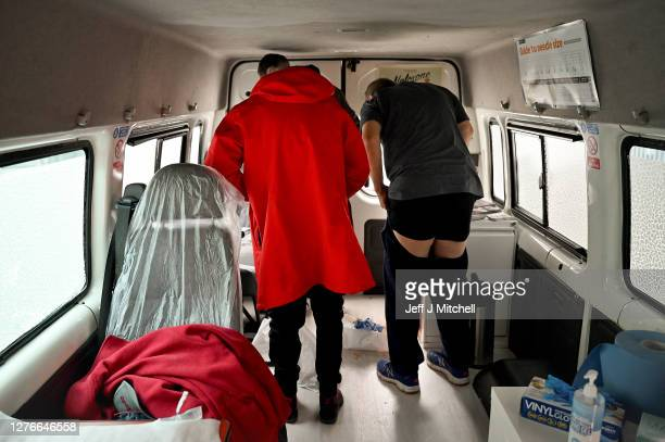 Drug users inject, inside of a Safe Consumption van set up by Peter Krykant on September 25, 2020 in Glasgow, Scotland. Peter a recovering heroin...