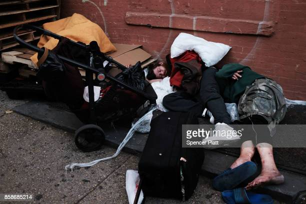 Drug users lay passed out along a street in a South Bronx neighborhood which has the highest rate of heroininvolved overdose deaths in the city on...