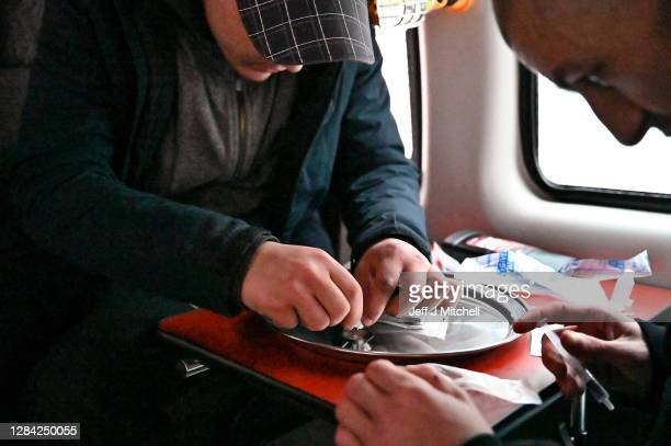 Drug users prepare cocaine before injecting, inside of a safe consumption van set up by Peter Krykant on November 6,2020 in Glasgow, Scotland. Peter,...