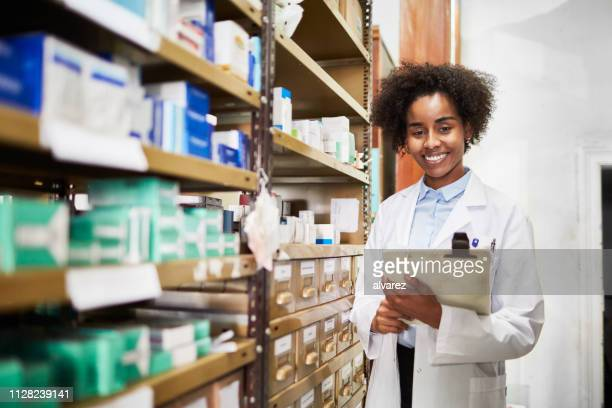 druggist at medicine storage room at pharmacy - medical supplies stock pictures, royalty-free photos & images