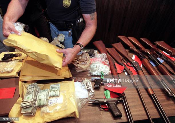 Drugs cash and guns were among items recovered in raid on 37 gang locations carried out Tuesday morning by Compton police and nine other federal...