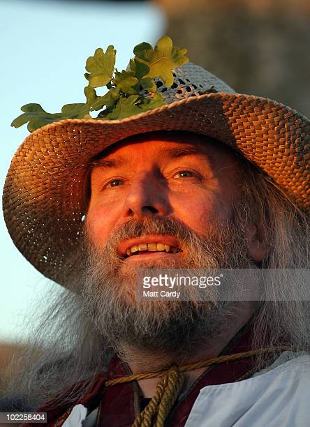 A druid looks to the sky at a Solstice sunset service as people gather in the megalithic monument of Stonehenge on June 20 2010 on the edge of...