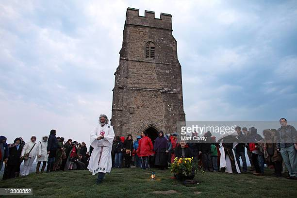 Druids and pagans conduct a May Day dawn celebration service in front of St Michael's Tower on Glastonbury Tor on May 1 2011 in Glastonbury England...