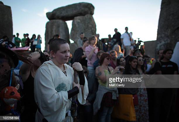 Druids conduct a Solstice sunset service as people gather in the megalithic monument of Stonehenge on June 20 2010 on the edge of Salisbury Plain...