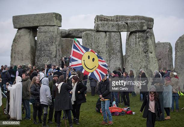 Druids pagans and revellers gather at Stonehenge hoping to see the sun rise as they take part in a winter solstice ceremony at the ancient neolithic...