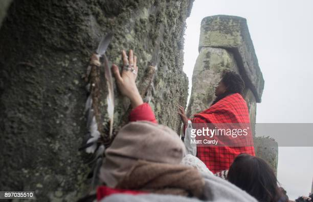 Druids pagans and revellers gather in the centre of Stonehenge hoping to see the sun rise as they take part in a winter solstice ceremony at the...