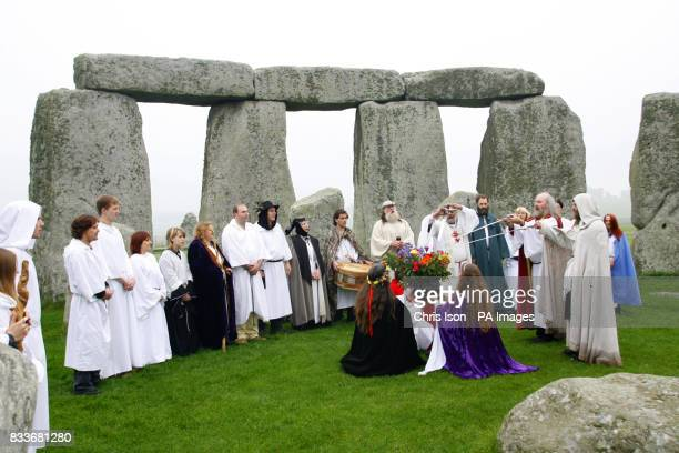 Druids perform a Samhain or pagan Halloween style blessing ceremony at Stonehenge in Wiltshire