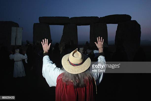 Druids wait for the sun to rise as they celebrate the Spring Equinox at Stonehenge on March 20 2009 near Amesbury Wiltshire England Several hundred...