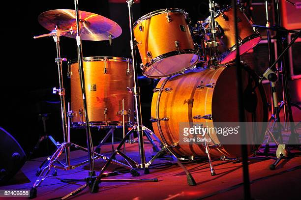 Drum kit illuminated on stage
