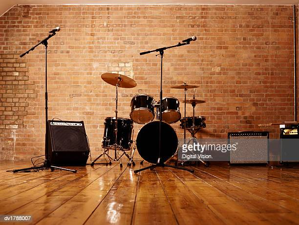 drum kit, microphones and loudspeakers in a studio - drum kit stock photos and pictures