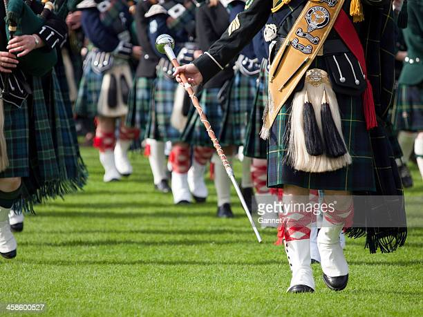 Drum Major and Pipe Band at the Lonach Gathering, Scotland