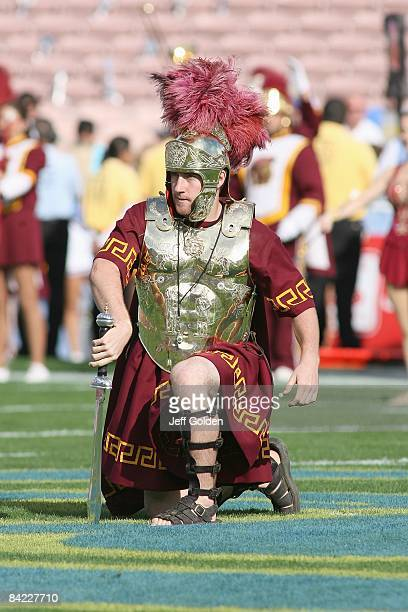 Drum Major Ed Carden of the USC Trojans Maching Band places a sword in midfield before the game against the UCLA Bruins on December 6, 2008 at the...