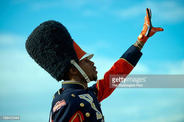 Drum major Isaac Lee commandeering Trojan Explosion from the bleachers during a game between Virginia State University and Norfolk State University...