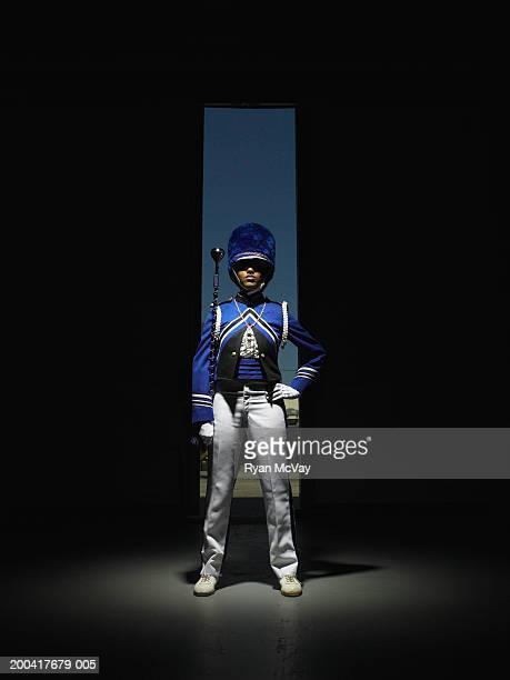 drum majorette holding baton, hand on hip, portrait - backstage stock pictures, royalty-free photos & images