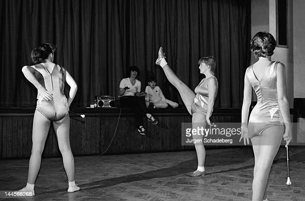 Drum majorettes rehearse at a London community hall 1982