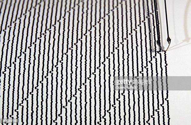 A drum seismograph records the shaking of the ground at the new earthquake monitoring station June 23 2004 at the Museum of Natural History in New...
