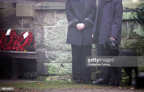 Drum, the pet dog of Lord Patrick Lichfield, is held on a lead before Lord Lichfield's funeral at St Michael and All Angels Church on November 21...