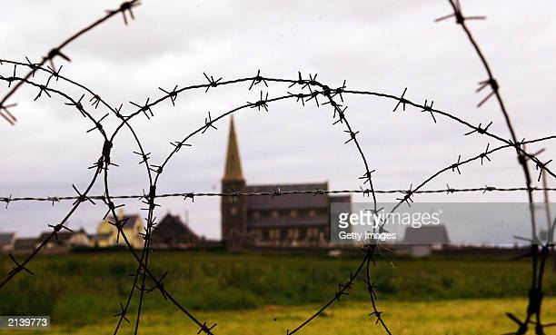 Drumcree Anglican Church pictured on July 6, 2003 in Portadown, County Armagh, Northern Ireland. A steel barrier and a large Army and Police presence...