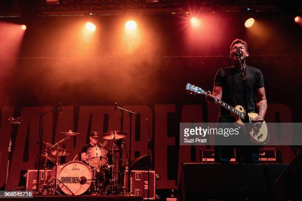 Drummer Adam Pfahler and lead guitarist and vocalist Blake Schwarzenbach of Jawbreaker performs live on stage during Upstream Music Festival in...