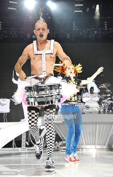 IRVINE CA JULY 31 Drummer Adrian Young of No Doubt and singer Hayley Williams of Paramore perform at Verizon Wireless Amphitheater on July 31 2009 in...