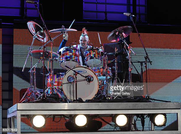 Drummer Adrian Young performs during a fashion show at the Macy's Passport 2008 Gala at Santa Monica Airport's Barker Hangar on September 25 2008 in...