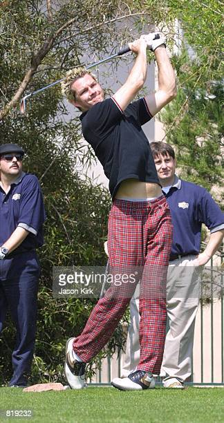 Drummer Adrian Young tees off during the 2nd Annual Mark Brian Celebrity Golf Tournament March 17 2001 in Fullerton CA
