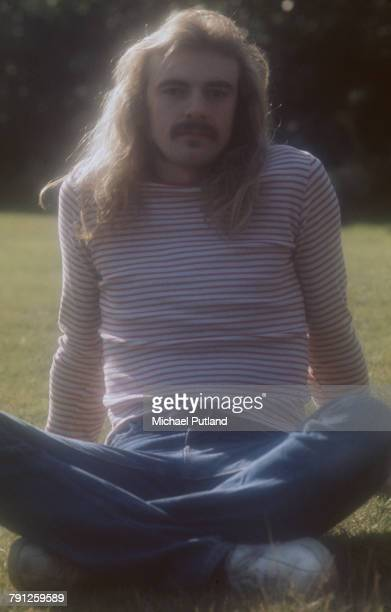 Drummer Alan White of English progressive rock band Yes posed crosslegged in 1974
