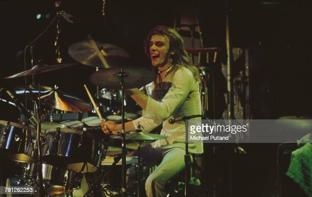 Drummer Alan White performs live on stage with English progressive rock group Yes in London in 1973