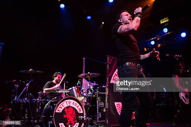 Drummer Alex Sassaris and vocalist / guitarist Taki Sassaris of Eve To Adam perform at House of Blues Sunset Strip on November 13 2012 in West...