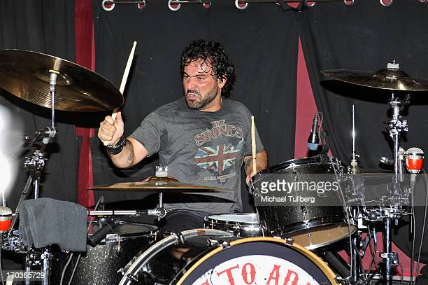 Drummer Alex Sassaris of the rock group Eve To Adam performs live at On The Rox at The Roxy Theatre on June 11 2013 in West Hollywood California