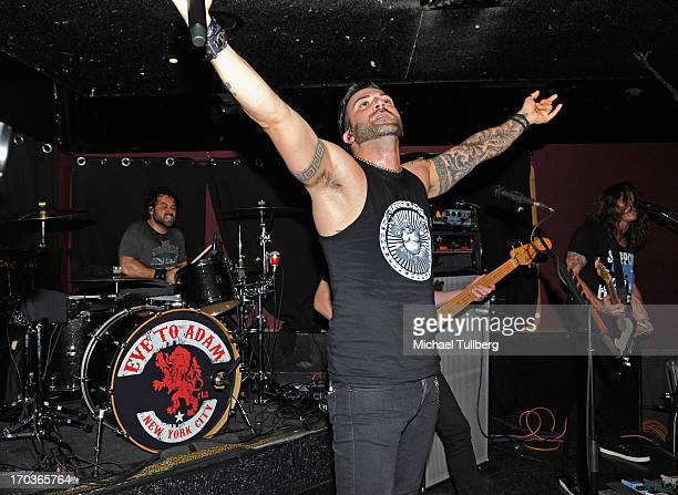 Drummer Alex Sassaris singer Taki Sassaris and guitarist Adam Latiff of the rock group Eve To Adam perform live at On The Rox at The Roxy Theatre on...