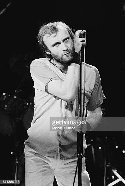 Drummer and singer Phil Collins performing with English progressive rock group Genesis at the Broome County Veterans Memorial Arena Binghamton New...