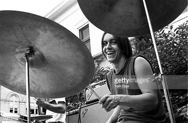 Drummer and student at the University of Michigan James Osterberg, Jr. Performs with his band The Prime Movers in the front garden of a house on...