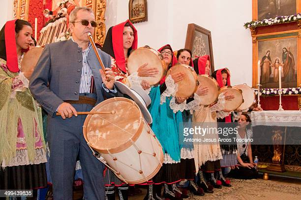 CONTENT] Drummer and women of the town of Almonaster la Real Huelva playing drums and tambourines dressed in typical costumes inside the Church