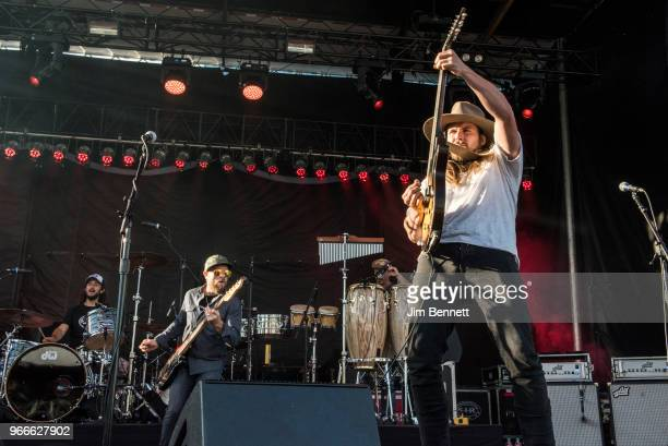 Drummer Anthony LoGerfo bassist Corey McCormick and vocalist and guitarist Lukas Nelson perform live on stage during Upstream Music Festival at...