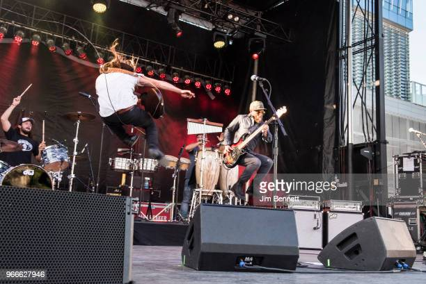 Drummer Anthony LoGerfo vocalist and guitarist Lukas Nelson and bassit Corey McCormick of Lukas Nelson and Promise of the Real perform live on stage...