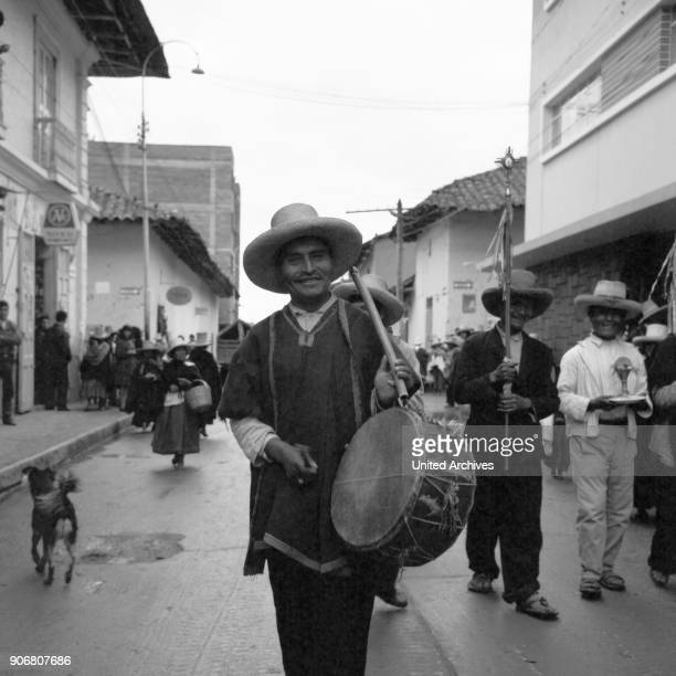 Drummer at a parade through the streets of Cajamarca, Peru 1960s.