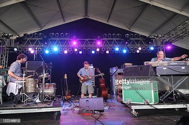 Drummer Billy Martin Bassist Chris Wood and Keyboardist John Medeski of Medeski Martin and Wood perform during Day 4 of the Bonnaroo Music and Arts...