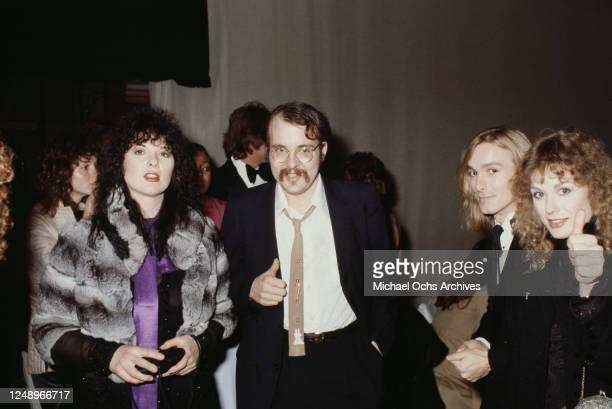 Drummer Bun E Carlos and singer Robert Zander of rock band Cheap Trick, with sisters Ann and Nancy Wilson of American rock band Heart, circa 1975.