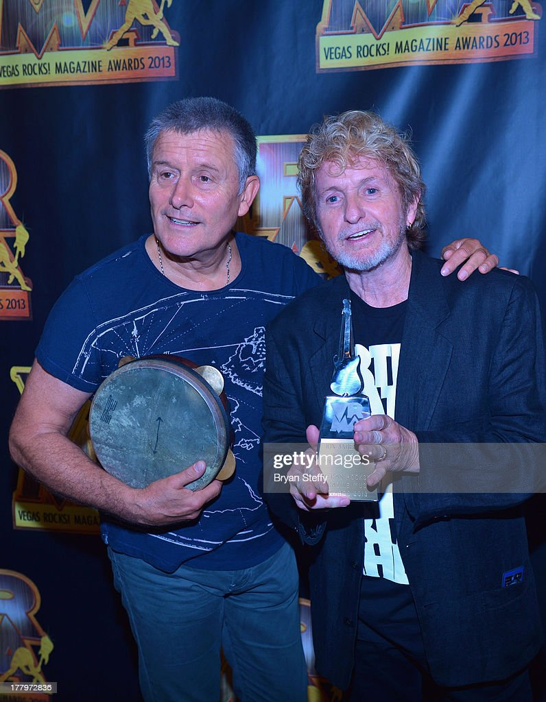 Drummer Carl Palmer (L) and musician/songwriter Jon Anderson appear backstage at the Vegas Rocks! Magazine Music Awards 2013 at the Joint inside the Hard Rock Hotel & Casino on August 25, 2013 in Las Vegas, Nevada.