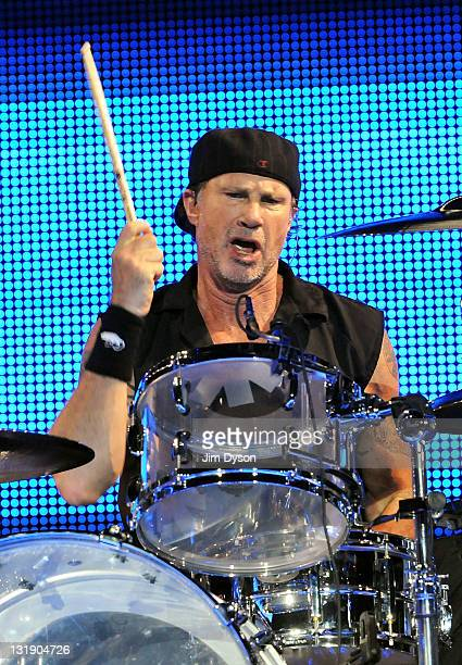Drummer Chad Smith of American rock band Red Hot Chili Peppers performs live on stage at the O2 Arena on November 7, 2011 in London, England.